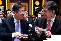 Vice Mayor of Shanghai Tu Guangshao (left), and French Financial Markets Authority Chairman Jean-Pierre Jouyet (right), at Shanghai / Paris Europlace Financial Forum, in Shanghai, China, on December 1, 2010. Photo by Lucas Schifres/Pictobank