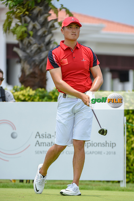 Zheng Kai BAI (CHN) watches his tee shot on 12 during Rd 4 of the Asia-Pacific Amateur Championship, Sentosa Golf Club, Singapore. 10/7/2018.<br /> Picture: Golffile | Ken Murray<br /> <br /> <br /> All photo usage must carry mandatory copyright credit (© Golffile | Ken Murray)