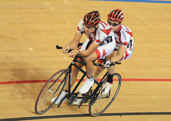 LONDON, ENGLAND – 08/24/2012:  Daniel Chalifour and pilot Alexandre Cloutier during a training session at the London 2012 Paralympic Games at The Velodrome. (Photo by Matthew Murnaghan/Canadian Paralympic Committee)