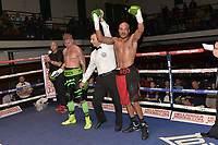 Rod Douglas (red/black shorts) defeats Duane Green during a Boxing Show at York Hall on 6th October 2018