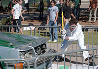 "Brothers from the Oxy chapter of Phi Kappa Psi organized a ""car smash"" fundraiser on campus, part of Movember, a month-long effort to raise awareness for men's health issues such as prostate and testicular cancer. Nov. 13, 2012. (Photo by Marc Campos, Occidental College Photographer)"