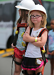 Elodie Pavlov, 5, waits her turn to ride in an NV Energy aerial bucket at the Touch-a-Truck event at the Carson City Library in Carson City, Nev., on Saturday, Aug. 5, 2017. <br /> Photo by Cathleen Allison/Nevada Photo Source