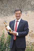 Xavier Perromat, winemaker with a bottle of Chateau de Cerons wine Chateau de Cerons (Cérons) Sauternes Gironde Aquitaine France