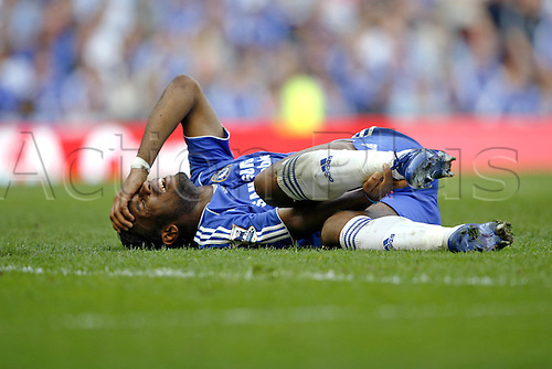 15 April 2007: Chelsea striker Didier Drogba lies injured during the FA Cup Semi Final between Chelsea and Blackburn Rovers. Chelsea won the game 2-1 after extra time. the game was played at Old Trafford, Manchester. Photo: Neil Tingle/actionplus...070415 football soccer player injury hurt