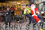 Local Gardai held a charity concert in aid of the Kerry branch of the Irish Kidney Association on Tuesday in photo are Christy McCarthy, Garda Dave Rath and Santa Claus aka Jerry Quinlan.