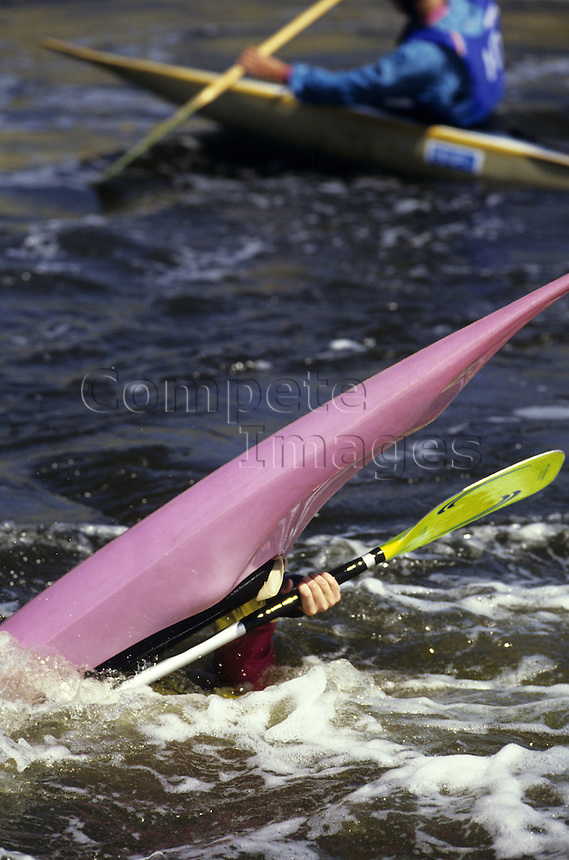 Kayaker capsizing on a river