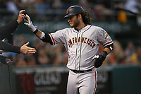 OAKLAND, CA - JULY 31:  Brandon Crawford #35 of the San Francisco Giants celebrates with his teammates after scoring a run against the Oakland Athletics during the game at the Oakland Coliseum on Monday, July 31, 2017 in Oakland, California. (Photo by Brad Mangin)