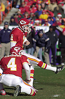 Kansas City Chiefs kicker Todd Peterson kicks a field goal while Dan Stryzinski holds during the game against the San Diego Chargers at Arrowhead Stadium in Kansas City, Missouri on December 23, 2001. The Chiefs won 20-17.