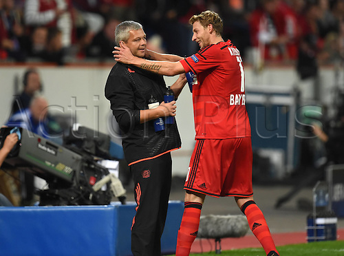 27.08.2014. Leverkusen, Germany. UEFA Champions League qualification match. Bayer Leverkusen versus FC Copenhagen.  Stefan Kiessling (Bayer 04 Leverkusen)celebrates with Physiotherapist Sven Elsinger<br />