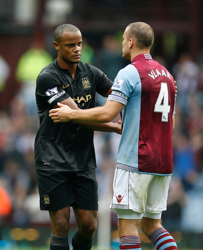 Manchester City's Vincent Kompany (L) shakes hands with Aston Villa's Ron Vlaar at the final whistle<br /> <br /> Photo by Jack Phillips/CameraSport<br /> <br /> Football - Barclays Premiership - Aston Villa v Manchester City - Saturday 28th September 2013 - Villa Park - Birmingham<br /> <br /> &copy; CameraSport - 43 Linden Ave. Countesthorpe. Leicester. England. LE8 5PG - Tel: +44 (0) 116 277 4147 - admin@camerasport.com - www.camerasport.com