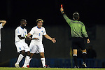 06 December 2014: North Carolina's Boyd Okwuonu (4) and Tyler Engel (8) react as referee Alex Gorin issues a red card to teammate Alex Olofson (not pictured). The University of California Los Angeles Bruins hosted the University of North Carolina Tar Heels at Drake Stadium in Los Angeles, California in a 2014 NCAA Division I Men's Soccer Tournament Quarterfinal round match. The game ended in a 3-3 tie after two overtimes. UCLA advanced to the next round by winning the penalty kick shootout 7-6.
