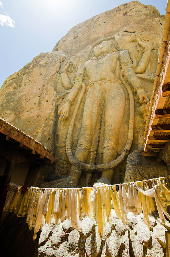 The stunning 8m tall Maitreya-Buddha relief, carved out of a rock face at the Chamba Gompa, along the Srinagar to Leh road. Mulbekh, Ladakh, India.