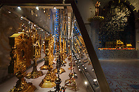 Cabinet of monstrances and reliquaries, and on the right, the huge aluminium valance made with Arsculpt and Technical Industrie, with glass beads gilded with gold leaf made with Murano glassmaker Salviati, in the Bell tower room themed 'Le Merveilleux' or The Supernatural, first floor, in Le Tresor de la Cathedral d'Angouleme, in Angouleme Cathedral, or the Cathedrale Saint-Pierre d'Angouleme, Angouleme, Charente, France. The 12th century Romanesque cathedral was largely reworked by Paul Abadie in 1852-75. In 2008, Jean-Michel Othoniel was commissioned by DRAC Aquitaine - Limousin - Poitou-Charentes to display the Treasure of the Cathedral in some of its rooms, which opened to the public on 30th September 2016. The cement floor tiles made by MiraColour and the hand printed wallpaper by Atelier d'Offard, both use interlacing patterns reminiscent of the Neo-Romanesque period of the 19th century. Picture by Manuel Cohen. L'autorisation de reproduire cette oeuvre doit etre demandee aupres de l'ADAGP/Permission to reproduce this work of art must be obtained from DACS.