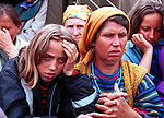 Ethnic Albanian refugees from Kosovo arriving on a bus into Cegrane, a refugee camp outside Skopje, Macedonia  on May 23, 1999.  Hundreds of thousands of people fled into Macedonia and Albania during the Serb terror of Kosovo..(Photo: Per-Anders Pettersson/ Getty Images)
