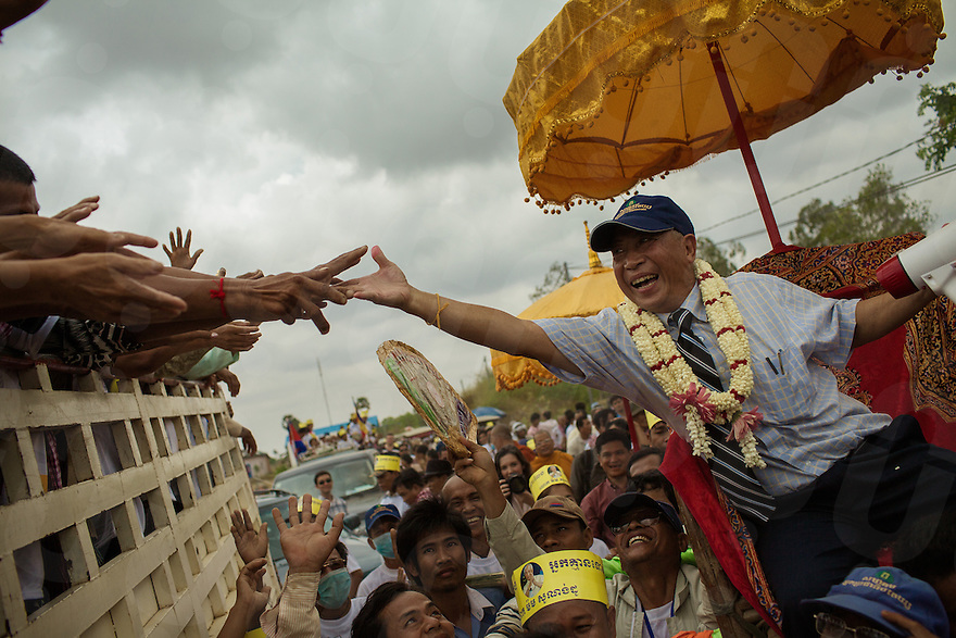 March 15, 2013 - Phnom Penh. Cambodian activist Mam Sonando is carried on a chair to cheers from thousands of supporters, gathered in front of Phnom Penh's Prey Sar prison, minutes after his release. Charged with insurrection, Sonando has spent a total of eight months in jail. © Thomas Cristofoletti / Ruom