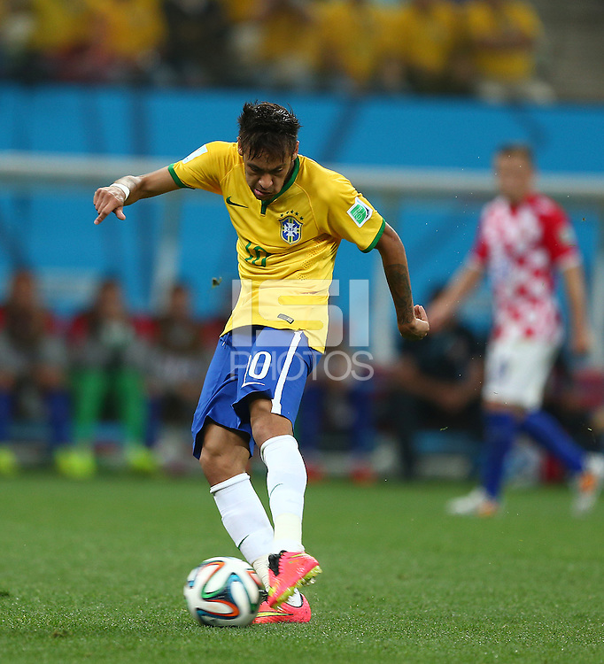 Neymar of Brazil scores a goal to make the score 1-1