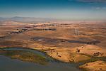 Aerial over the Montezuma Hills Windmill wind turbine wind farm, Solano County, California
