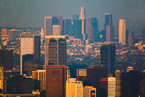 View of downtown Los Angeles and Century City in the foreground from the mountains above Santa Monica in early evening.
