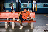 A man sits on the platform at the New Delhi train station as the Himsagar Express 6318 train halts for an hour to clean and replenish supplies on the train on 7th July 2009.. .6318 / Himsagar Express, India's longest single train journey, spanning 3720 kms, going from the mountains (Hima) to the seas (Sagar), from Jammu and Kashmir state of the Indian Himalayas to Kanyakumari, which is the southern most tip of India...Photo by Suzanne Lee / for The National