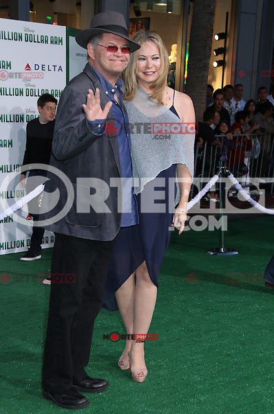 HOLLYWOOD, CA - MAY 6:  Micky Dolenz, Donna Quinter at the Premiere Of Disney's 'Million Dollar Arm'  on May 6, 2014 at El Capitan Theatre in Hollywood, California. Credit: SP1/Starlitepics /nortephoto.com
