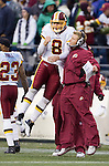 Washington Redskins quarterback Rex Grossman celebrates with Redskins coach after throwing a 51-yard touchdown pass to wide receiver Anthony Armstrong in the fourth quarter at CenturyLink Field in Seattle, Washington on November 27, 2011. Redskins stunned the Seattle Seahawks 23-17. UPI/Jim Bryant ©2011 Jim Bryant Photo. All Rights Reserved.