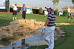 Rory McIlroy's looks on in disbelief as his 3rd shot ends up in the stream at the 18th green during  Day 3 at the Dubai World Championship Golf in Jumeirah, Earth Course, Golf Estates, Dubai  UAE, 21st November 2009 (Photo by Eoin Clarke/GOLFFILE)
