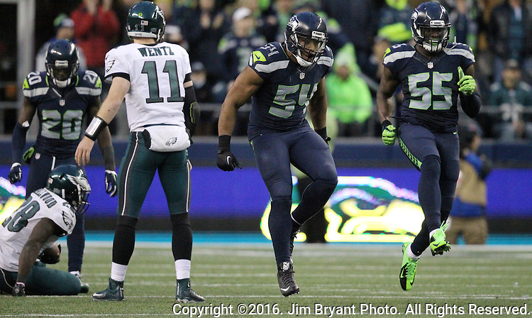 Seattle Seahawks middle linebacker Bobby Wagner (54) and Seattle Seahawks defensive end Frank Clark (55)) celebrates after dropping Philadelphia Eagles running back Wendell Smallwood (28) for a loss at CenturyLink Field in Seattle, Washington on November 20, 2016.  Seahawks beat the Eagles 26-15.  ©2016. Jim Bryant Photo. All Rights Reserved.