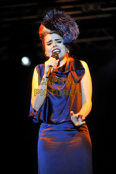 Paloma Faith.The Big Feastival, Alex James' Farm, Kingham, Oxfordshire, England..September 1st 2012.on stage in concert live gig performance performing music half length blue dress sleeveless fur hat singing hand arm.CAP/JIL.©Jill Mayhew/Capital Pictures