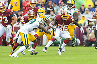 Landover, MD - September 23, 2018: Washington Redskins running back Adrian Peterson (26) avoids a tackle during the  game between Green Bay Packers and Washington Redskins at FedEx Field in Landover, MD.   (Photo by Elliott Brown/Media Images International)
