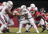 Hawgs Illustrated/BEN GOFF <br /> Grant Morgan (31), Arkansas linebacker, and McTelvin Agim (3), Arkansas defensive end, stop Aeris Williams (22), Mississippi State running back, in the fourth quarter Saturday, Nov. 18, 2017, at Reynolds Razorback Stadium in Fayetteville.