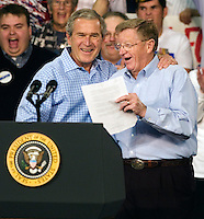 Stephen Brashear.President George W. Bush gives Sen. Conrad Burns a hug after Burns introduced him during the Montana Victory Rally at MetraPark Arena in Billings, Mont., Thurs., Nov. 3, 2006. Stephen Brashear/Bloomberg News