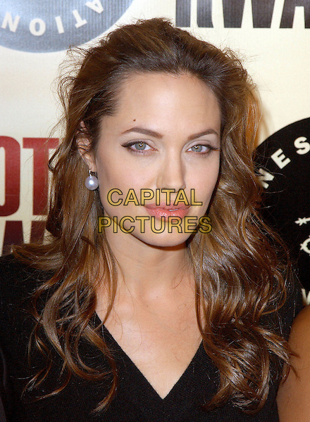 "ANGELINA JOLIE .Los Angeles Premiere of ""Hotel Rwanda"" held at The Academy Theatre in Beverly Hills, California.December 2nd, 2004.headshot, portrait, pearl earrings, jewellery.www.capitalpictures.com.sales@capitalpictures.com.Supplied by Capital Pictures."