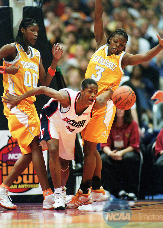 29 MAR 2002:  University of Tennessee center Michelle Snow (00) and guard Tasha Butts (3) hustle for a loose ball against UCONN forward Swin Cash (32) during their Division 1 Women's Basketball Semifinal game held at the Alamodome in San Antonio, TX.  UCONN defeated Tennessee 79-56 to advance to the national title game.  Jamie Schwaberow/NCAA Photos