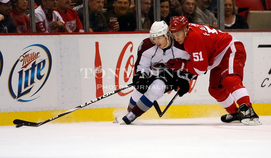 12 October 2010: Colorado Avalanche defenseman Kyle Cumiskey, left, gets close contact from Detroit Red Wings forward Valtteri Filppula (51), in the first period of the Colorado Avalanche at Detroit Red Wings NHL hockey game, at Joe Louis Arena, in Detroit, MI...***** Editorial Use Only *****