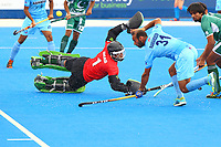 Goalkeeper Amjad Ali of Pakistan deflects a shot and prevents Ramandeep Singh of India from scoring during the Hockey World League Semi-Final 5-8th place match between Pakistan and India at the Olympic Park, London, England on 24 June 2017. Photo by Steve McCarthy.