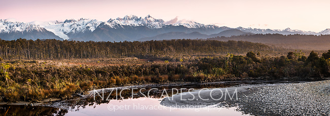 Dusk over Southern Alps with Mt. Tasman and Aoraki, Mt. Cook across Five Mile Lagoon, Westland Tai Poutini National Park, West Coast, UNESCO Wolrd Heritage Area, New Zealand, NZ
