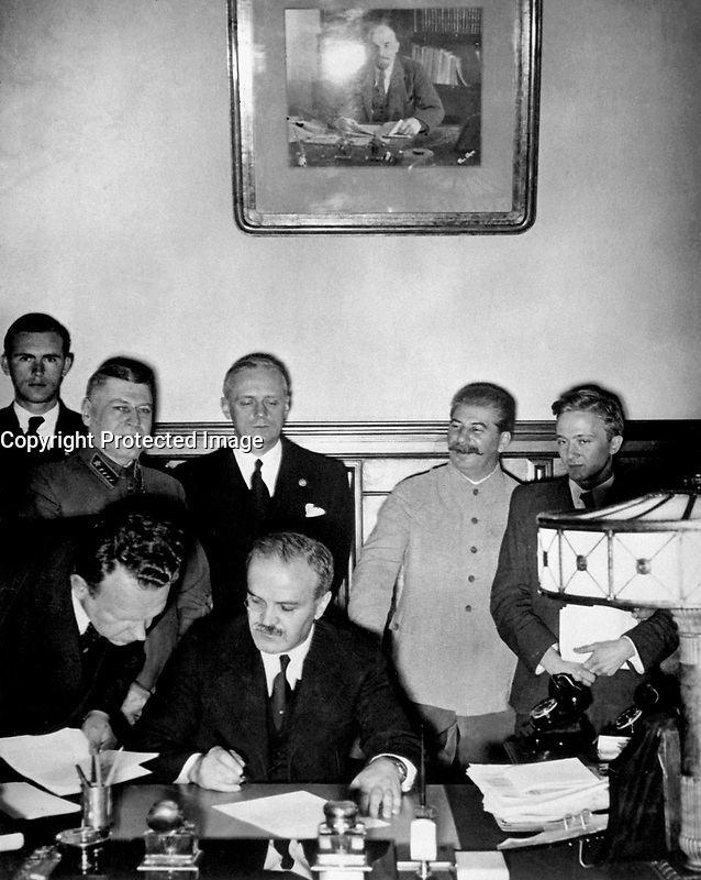 Soviet Foreign Minister Molotov signs the German-Soviet nonaggression pact; Joachim von Ribbentrop and Josef Stalin stand behind him, Moscow, August 23, 1939.  Von Ribbentrop Collection.  (Foreign Records Seized)<br /> NARA FILE #:  242-JRPE-44<br /> WAR &amp; CONFLICT BOOK #:  990