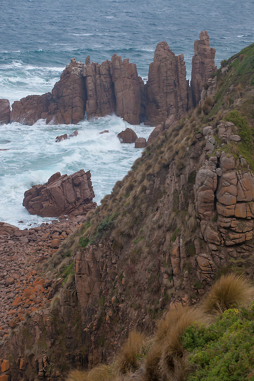 The sheer pinnacles of Cape Woolamai form the ocean battered headlands of Phillip Island, Victoria