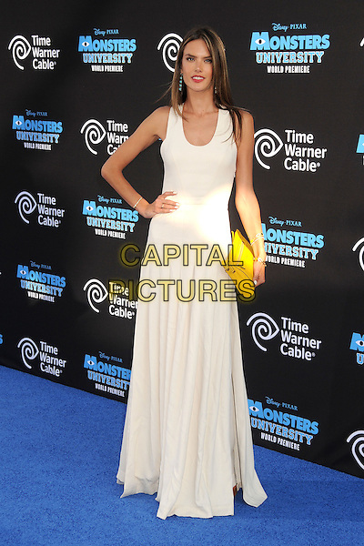 Alessandra Ambrosio  <br /> &quot;Monsters University&quot; Los Angeles Premiere held at the El Capitan Theatre, Hollywood, California, USA.<br /> June 17th, 2013<br /> full length dress yellow clutch bag white hand on hip <br /> CAP/ADM/BP<br /> &copy;Byron Purvis/AdMedia/Capital Pictures