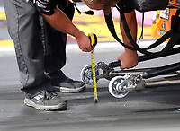 Oct 28, 2016; Las Vegas, NV, USA; Detailed view as crew member for NHRA pro stock driver Bo Butner uses a tape measurer to measure wheelie bar height during qualifying for the Toyota Nationals at The Strip at Las Vegas Motor Speedway. Mandatory Credit: Mark J. Rebilas-USA TODAY Sports