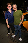 Jeff Marx (R) and husband (L) taking the 'Avenue Q' - 15th Anniversary Performance Taxi Cab at New World Stages on July 31, 2018 in New York City.