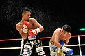 (L-R) Takashi Uchiyama (JPN), Jorge Solis (MEX), DECEMBER 31, 2011 - Boxing : Takashi Uchiyama of Japan and Jorge Solis of Mexico in action during the WBA super featherweight title bout at Yokohama Cultural Gymnasium in Kanagawa, Japan. (Photo by Hiroaki Yamaguchi/AFLO)