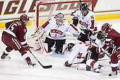 Katharine Chute (Harvard - 15), Leah Sulyma (NU - 1), Kristi Kehoe (NU - 34), Alyssa Wohlfeiler (NU - 8), Ashley Wheeler (Harvard - 12) - The Harvard University Crimson defeated the Northeastern University Huskies 4-3 (SO) in the opening round of the Beanpot on Tuesday, February 8, 2011, at Conte Forum in Chestnut Hill, Massachusetts.
