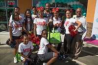 Morning Side High School Cheerleaders and Honorable Mayor Butts attend Just Weaves By Just Extensions Opens Up Its First Premium Weaving Installation Store In Inglewood, California