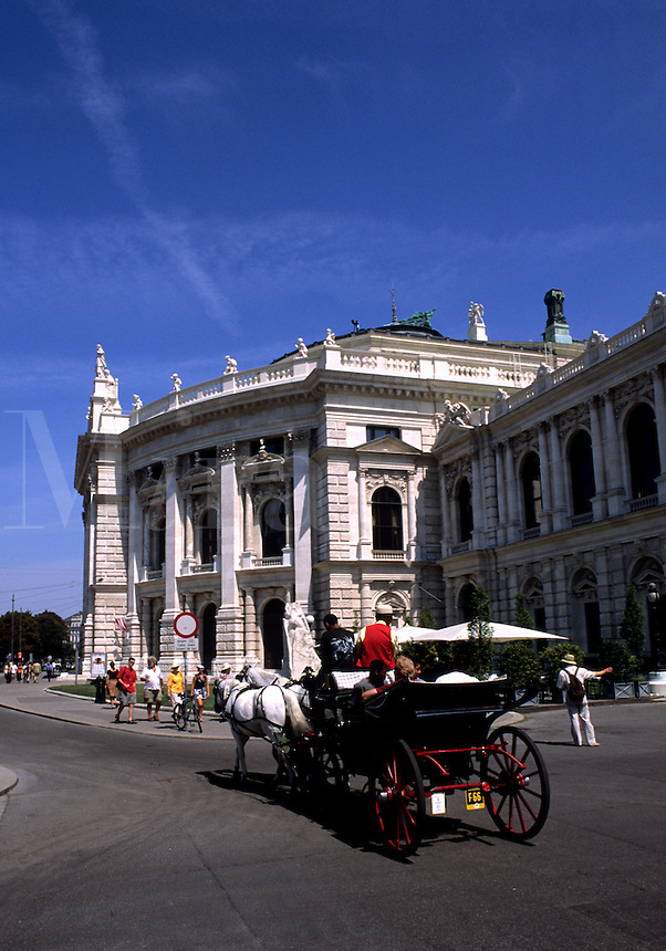 Horse carriages of tourists at Hofburg Imperial Palace in old town of Vienna Austria