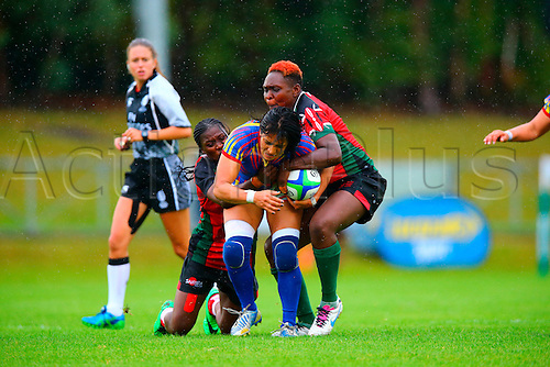23.08.2015. Dublin, Ireland. Women's Sevens Series Qualifier 2015. Kenya versus Colombia<br /> Janet Okello (Kenya) and Camilyne Oyuayo (Kenya) tackle Solangie Delgado (Colombia).