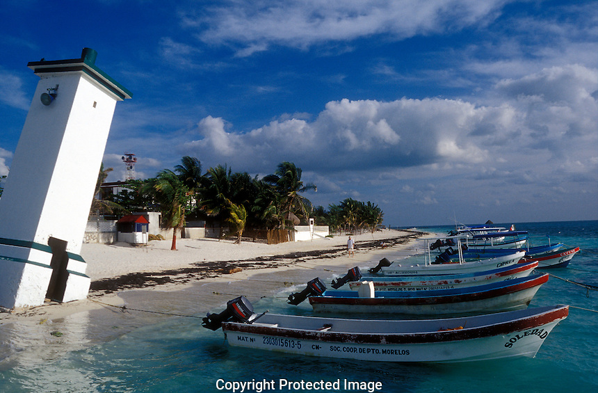 Fishing boats and beach in Puerto Morelos, Quintana Roo, Mexico
