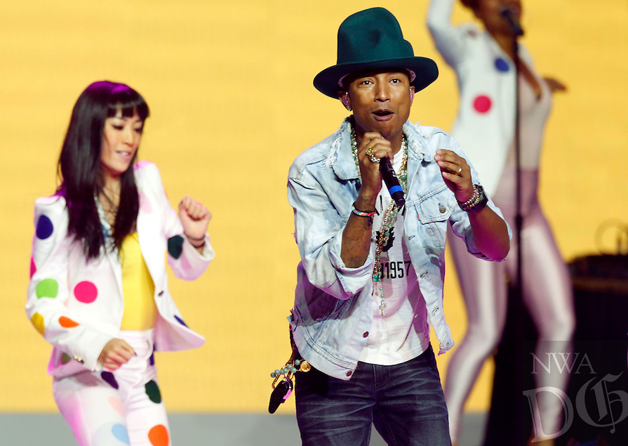 NWA Media/JASON IVESTER --06/06/2014--<br /> Pharrell Williams performs on stage on Friday, June 6, 2014, during the annual Shareholders Meeting inside Bud Walton Arena in Fayetteville.