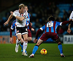 James McEveley of Sheffield Utd tackled by Tommy Rowe of Scunthorpe Utd - English League One - Scunthorpe Utd vs Sheffield Utd - Glandford Park Stadium - Scunthorpe - England - 19th December 2015 - Pic Simon Bellis/Sportimage