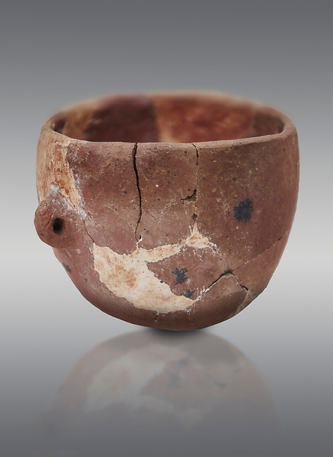 Neolithic terracotta bowl. Catalhoyuk collection, Konya Archaeological Museum, Turkey. Against a gray background